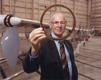 Picture of Paul McCready holding an airplane part
